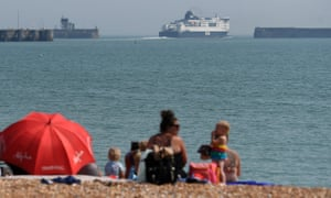 A family at the beach close to Dover Ferry terminal.