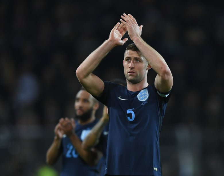 Cahill leads the applauds for the England supporters after the full time whistle.