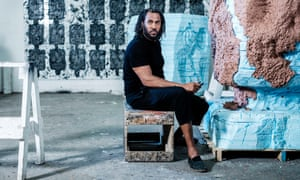 Rashid Johnson works on one of his sculptures in his studio.