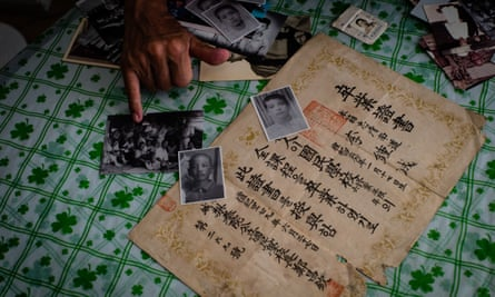 South Korean Lee Su-nam shows a selection of ageing family photos and his brother's high school diploma.