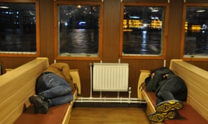 Two passengers asleep on the night ferry, in Istanbul.