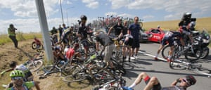 Scores of riders lie on the road