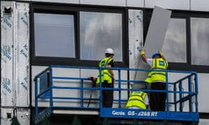 Cladding is removed from a tower block in Manchester for testing