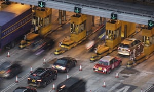 Vehicles queue up at the toll booths to enter Hong Kong's cross-harbour tunnel on Wednesday. It was shut for more than a week because of protests at the city's Polytechnic University.