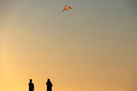 People flying kites near the cliffs at Kalbarri