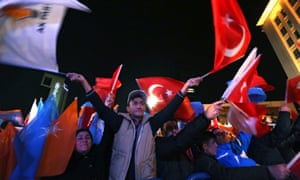 Supporters of Justice and Development Party (AKP) celebrate after hearing the early results of the general elections in front of the party's headquarters in Ankara.