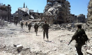 Syrian government forces patrol in Homs