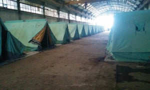 A row of tents installed to house refugees in an abandoned factory in Sindos