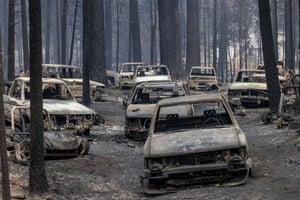 Nearly a dozen scorched vehicles destroyed by the Caldor fire abandoned along Evergreen Drive.