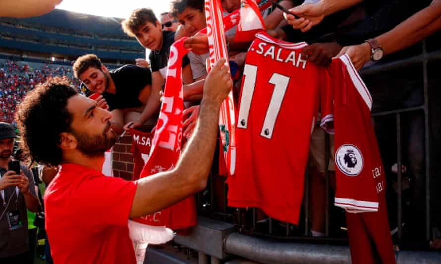 Liverpool's Mohamed Salah signs autographs for fans during his team's preseason tour of the US in 2018. Premier League clubs have huge followings in America