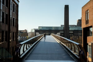A runner on an unusually quiet Millennium Bridge in London