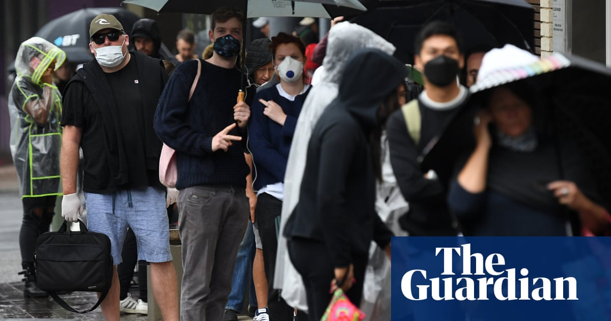 Newly unemployed Australians queue at Centrelink offices as MyGov website crashes again – The Guardian