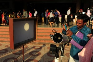 Mercury's transit is seen on a screen in a reflection from a telescope at the Birla planetarium in Chennai