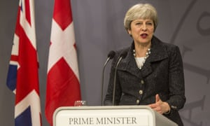 Theresa May speaks at a press conference in Copenhagen, Denmark.