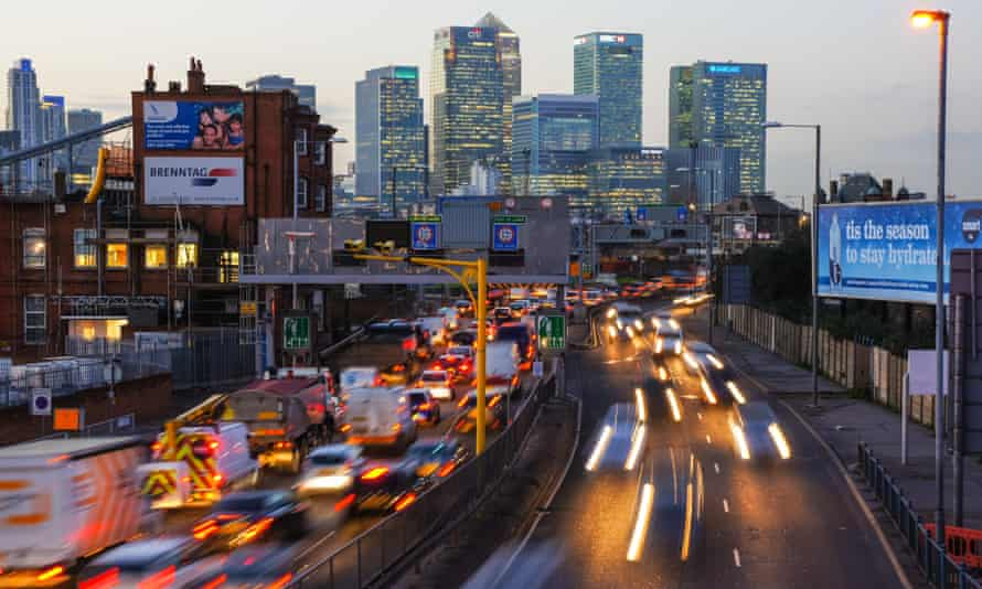 London traffic, near Canary Wharf. Failing to address carbon emissions from road transport – 90% of the total – are key to why the UK will miss its legally binding carbon targets.