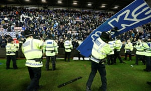 Manchester City fans start to launch advertising hoardings on to the pitch and in the direction of the police after the final whistle in a dark reminder of the in 1970s.