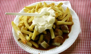 Chips and sausages on paper plate