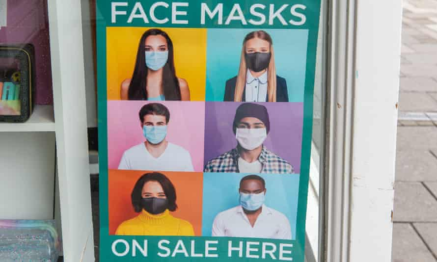 Face masks poster outside a UK shop