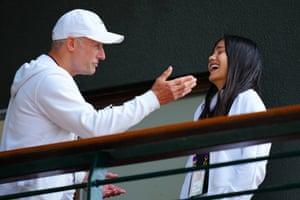 Raducanu shares a laugh with coach Nigel Sears at Wimbeldon