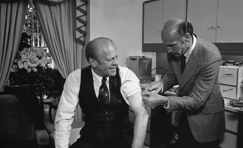 President Gerald Ford receives a swine flu inoculation from his White House physician, Dr William Lukash.