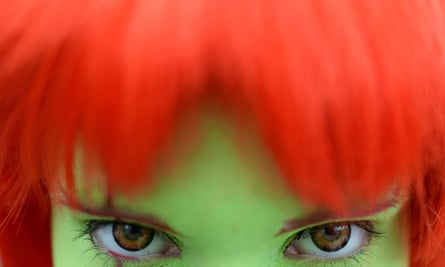 A woman wears coloured contact lenses.