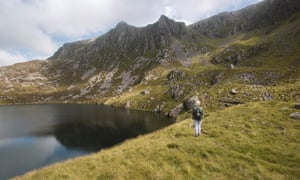 Jenny explores the Snowdonia landscape. The writer walks amid the mountains and lake at Llynnau Cwm Silyn.