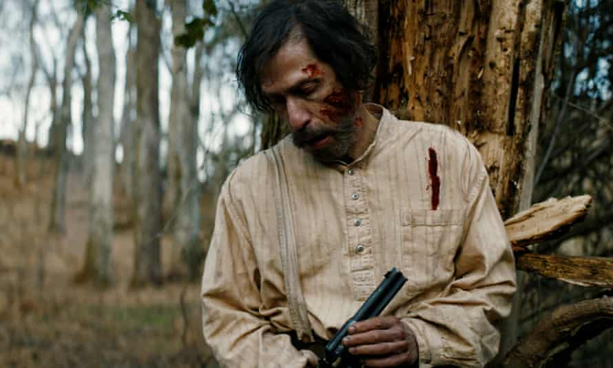 Goes at it with gusto ... Tim Blake Nelson (Henry) in Old Henry.