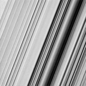 A region in Saturn's outer B ring. The many small, bright blemishes are created by cosmic rays and charged particle radiation near the planet.