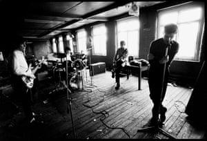 Joy Division (l-r, Bernard Sumner, Stephen Morris, Peter Hook, Ian Curtis) at TJ Davidson's rehearsal room, Little Peter Street, Manchester. 19 August 1979.