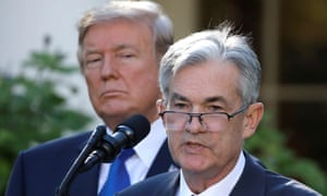 Donald Trump looks on as new Fed chair Jerome Powell speaks at the White House.