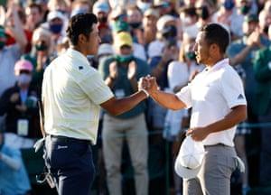 Japan's Hideki Matsuyama shakes hands with Xander Schauffele of the U.S.