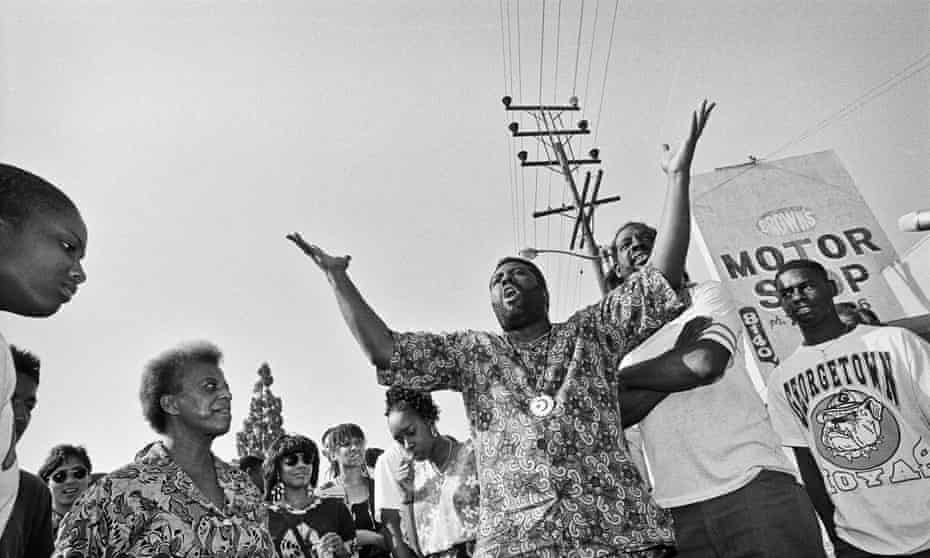 South central LA residents gather to ask for an end to the violence. During the riots businesses were burned to the ground and dozens of people were killed.