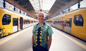 'It's a celebration of life, of other people' … Robinson at Sao Bento train station in Porto for Around the World by Train.
