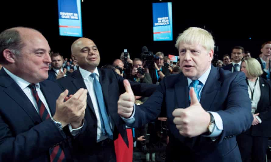 Boris Johnson leaves the stage after delivering his keynote speech to the Conservative party conference in Manchester.