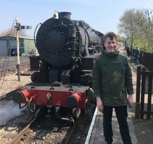 Luke Turner with a (full-sized) locomotive.