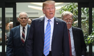 Trump leaves the summit, followed by chief of staff John Kelly and national security adviser John Bolton.