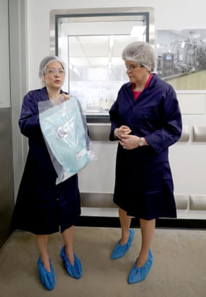 Montrose, UKHairnets and shoe covers in place, Scottish first minister Nicola Sturgeon is shown a bag of aluminium salts used in GSK vaccines by project leader Chooi Wan Wong. Sturgeon was attending the launch of the pharmaceuticals company's £44m site in Angus, which will produce ingredients to treat illnesses such as tetanus and pneumonia
