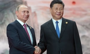 Russia's president, Vladimir Putin, left, shakes hands with China's president, Xi Jinping