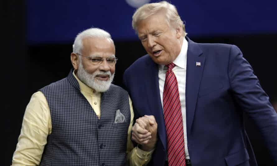 Donald Trump shakes hands with Indian Prime Minister Narendra Modi.