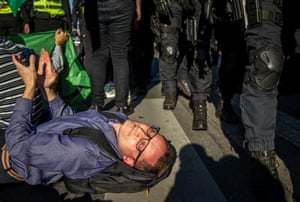 Prague, Czech Republic: police officers remove Extinction Rebellion protesters as they block a road