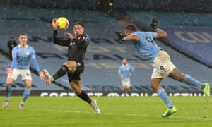 Gabriel Jesus of Manchester City heads towards goal as the ball hits the hand of Matty Cash of Aston Villa consequently leading to a penalty being awarded.