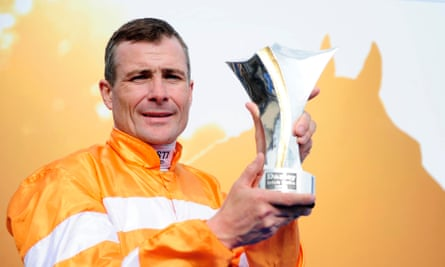 Pat Smullen holds the trophy after winning the Darley Irish Oaks on Covert Love in 2015.