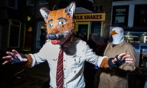 New Year's Eve, St Ives, Cornwall. Partygoers flood the streets of the Cornish fishing village in fancy dress