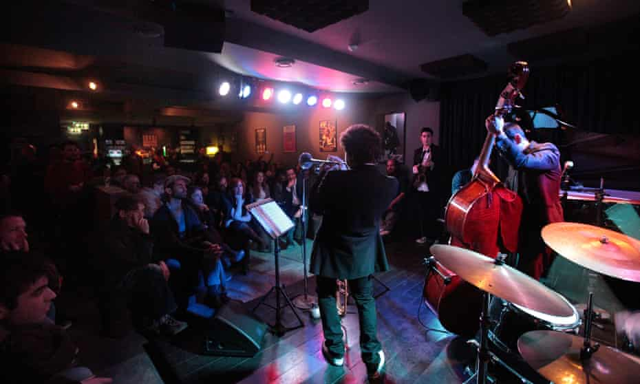 Performers on stage in front of a small audience at a nightime gig at Hot Clube de Portugal, Lisbon