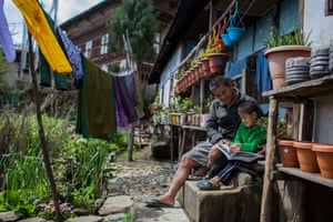 Dorji Duba, government ranger at Jigme Singye Wangchuck national park, at home with his son Yesel.