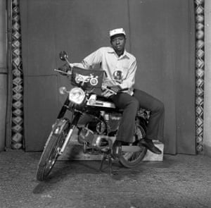 Man with motorcycle in studio