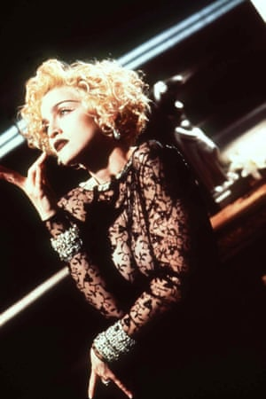 """1990: Vogue marked another career high and the singer's entry into a more vampish period of her career. Songs like Dear Jesse and Oh Father faded into the background as Madonna sang: """"Greta Garbo and Monroe, Deitrich and DiMaggio, Marlon Brando, Jimmy Dean. On the cover of a magazine."""" Strike a pose!"""