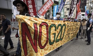 Demonstrators protest against the G20 summit in Osaka where Donald Trump and Xi Jinping are expected to have talks on the US-China trade dispute.