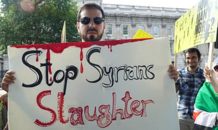A protester holding a placard to mark the second anniversary of the 22 August 2013 chemical attack that killed up to 1,400 people in the opposition-held area of Eastern Ghouta in Syria.