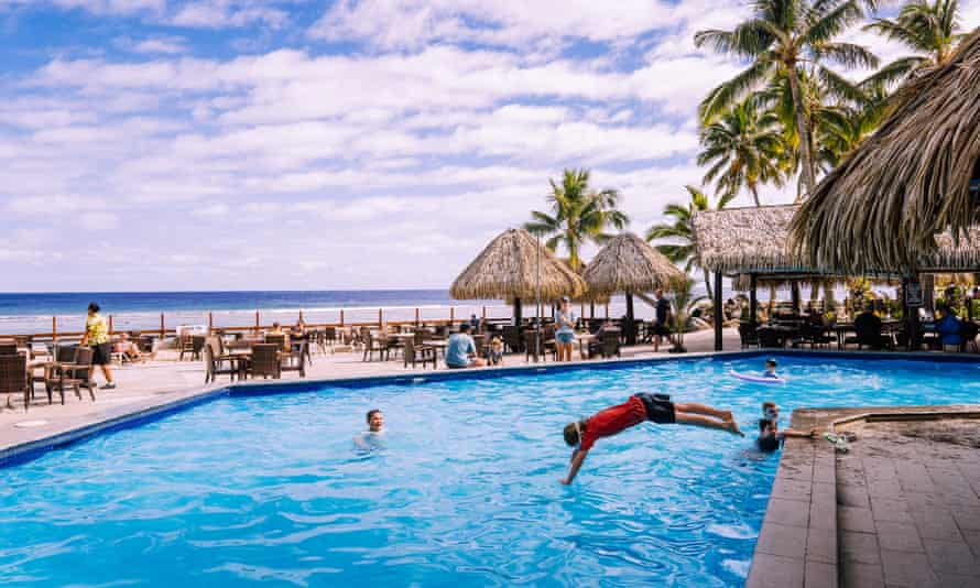 Tourists play in the pool at a resort in Rarotonga, Cook Islands.